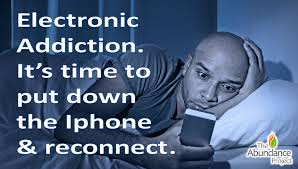 Man in bed with IPhone